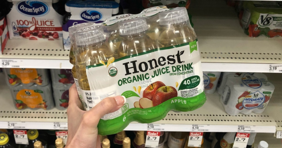 hand holding a 6-pack of Honest Organic Juice Drink in front of a store shelf
