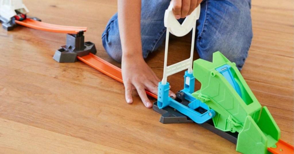 Kid building Hot Wheels Track Builder Set