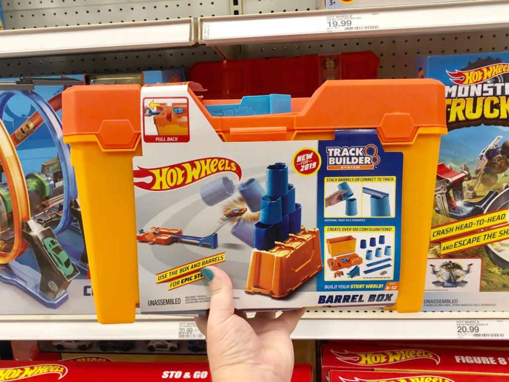 Hand holding Hot Wheels Track Builder Set at Target
