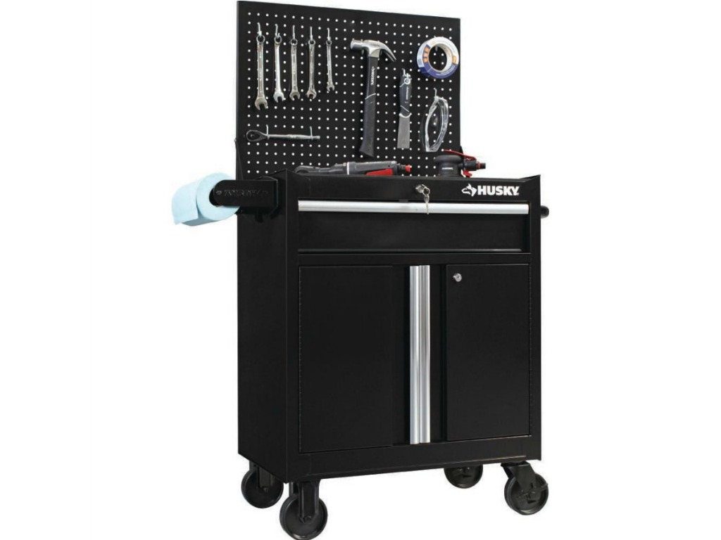 black rolling cabinet with tools hanging on attached pegboard