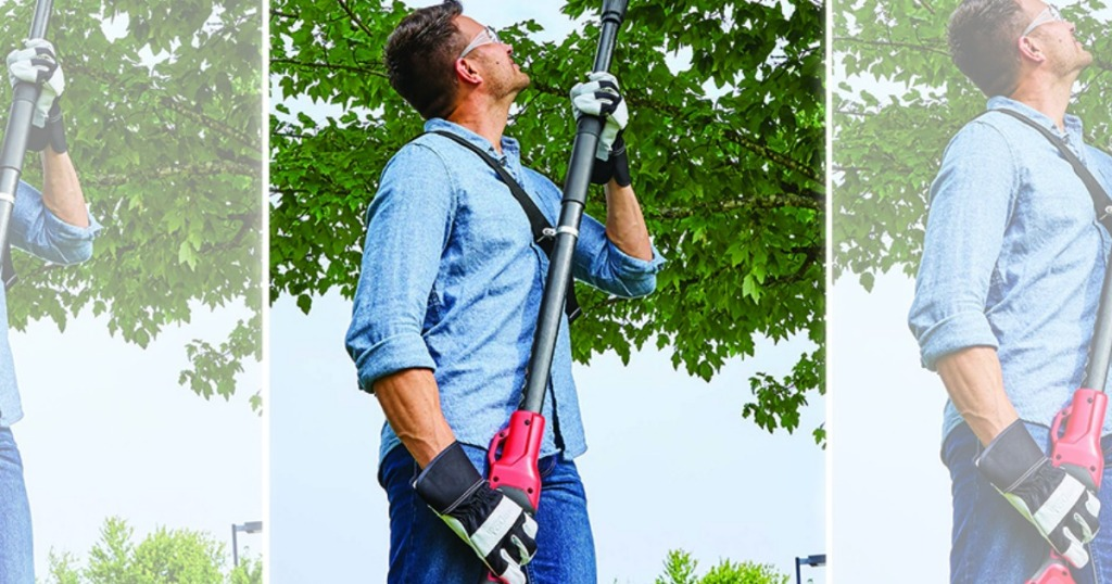 man holding pole saw