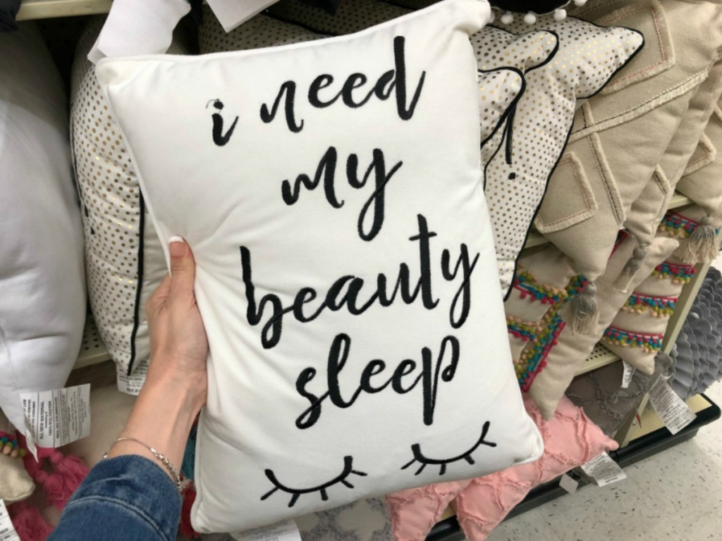 white rectangular pillow with i need my beauty sleep written on it