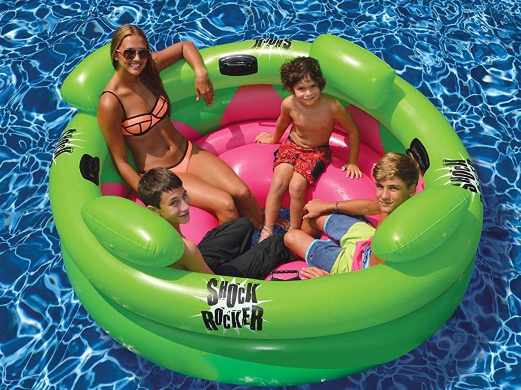 kids sitting in Swimline Inflatable Swimming Pool Shock Rocker
