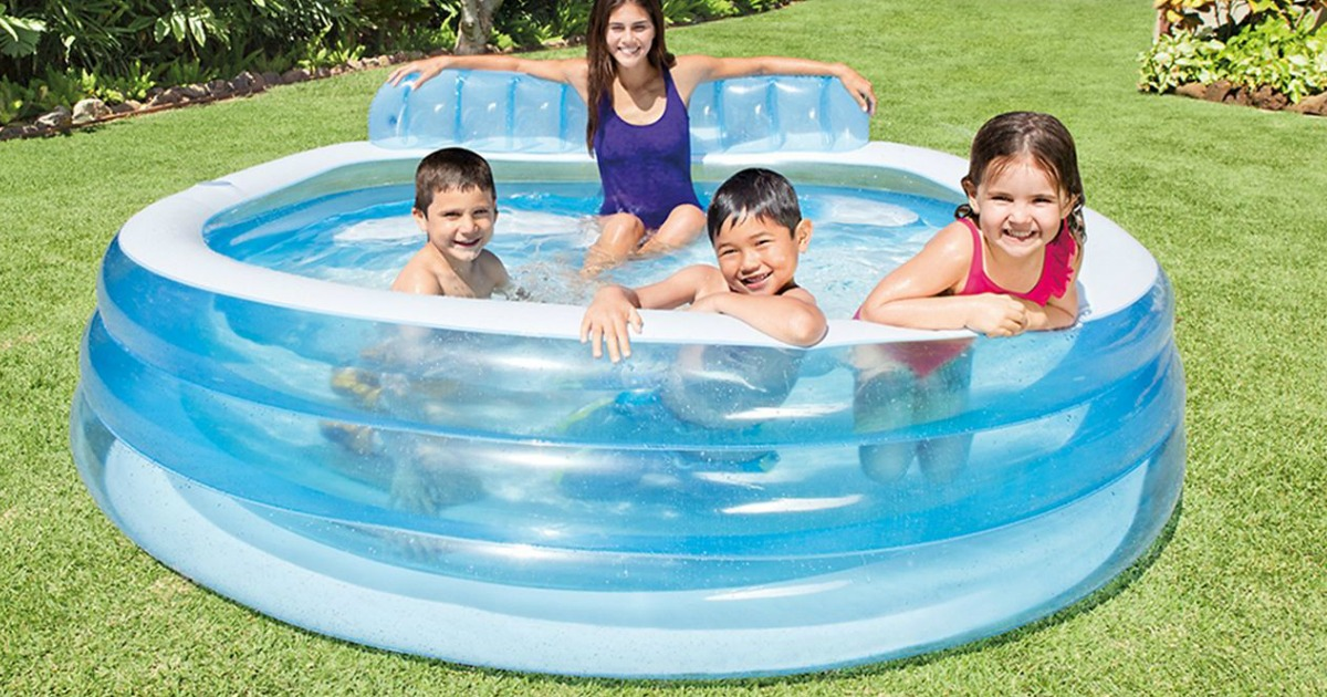 mom in inflatable pool with kids