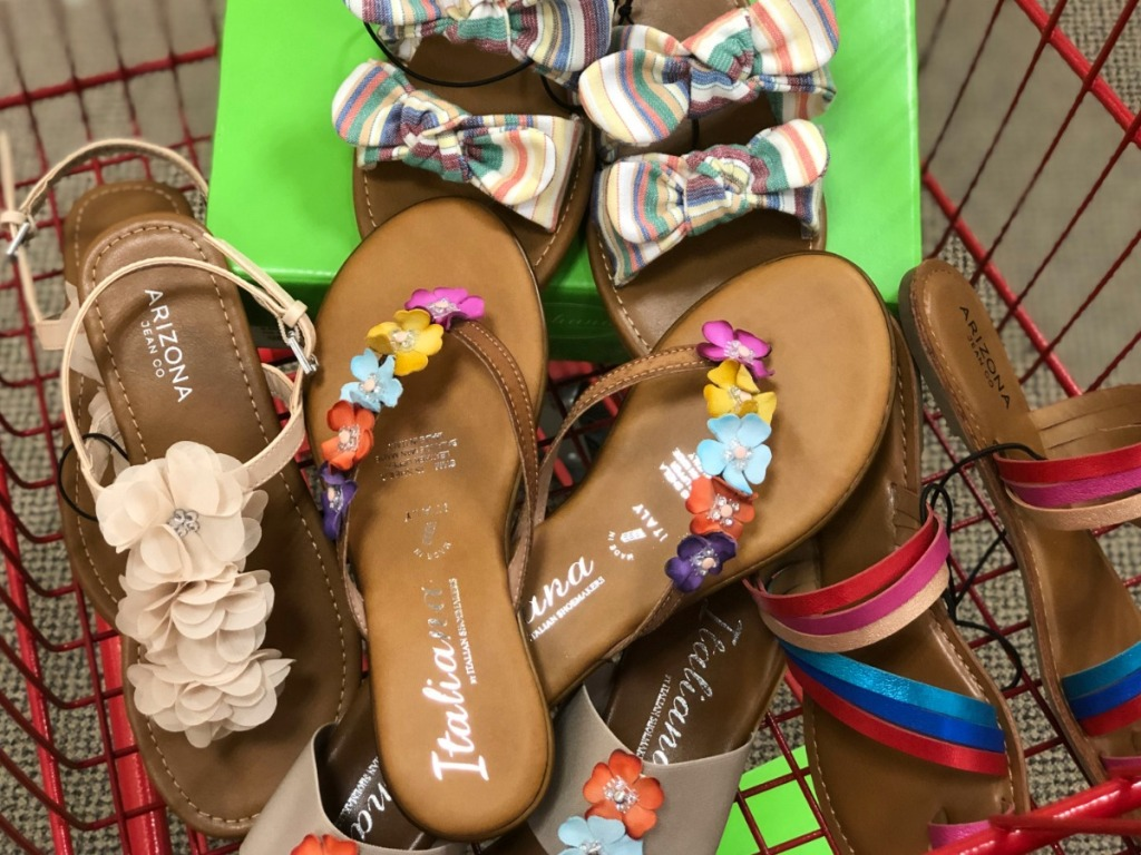 various pairs of sandals in a shopping cart at JCPenney
