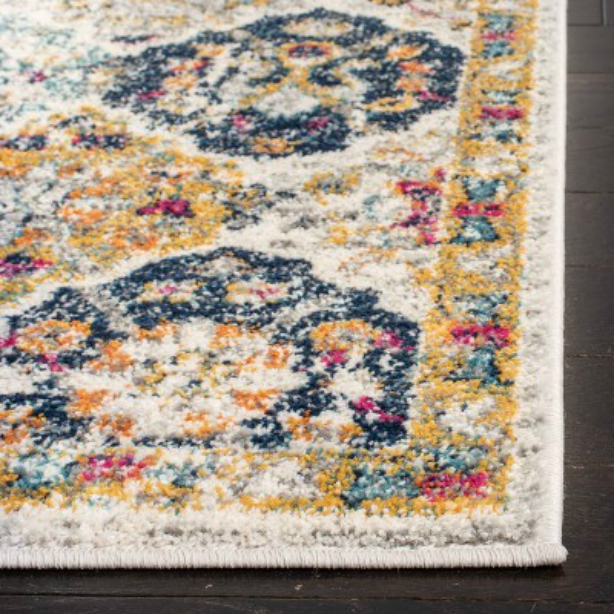 closeup of cream rug with multi-colored splotches