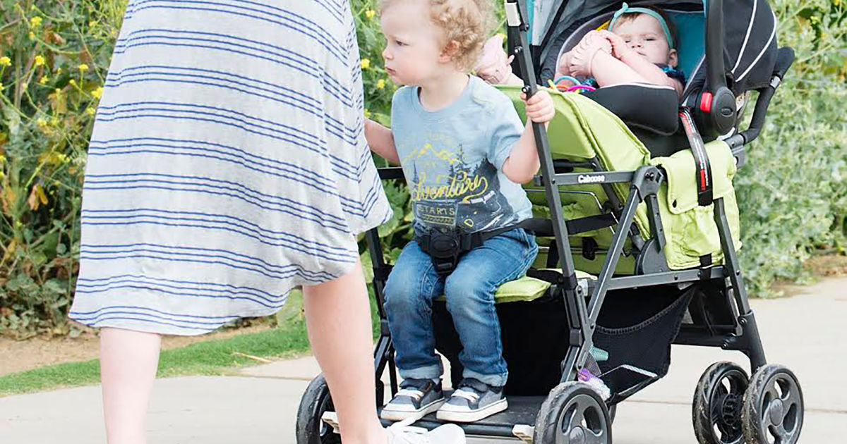 woman pushing toddler and baby in appletree joovy tandem stroller