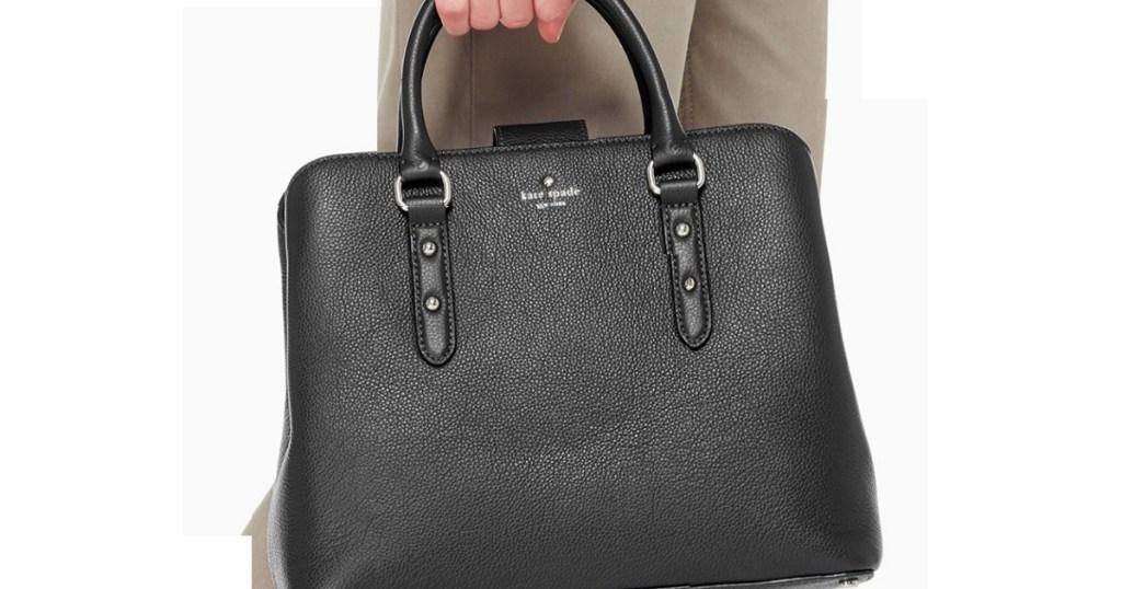 Kate Spade satchel being held by a woman