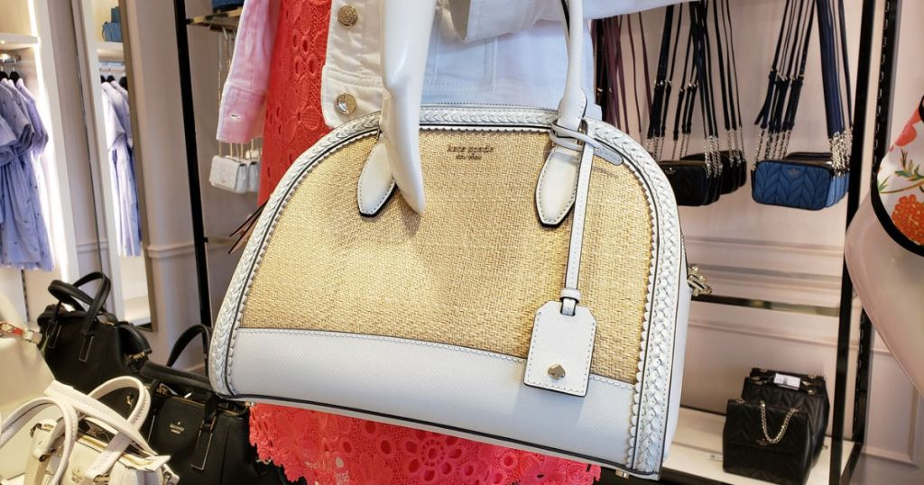 kate spade white and beige satchel purse at store