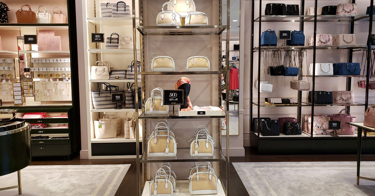 kate spade white and beige satchels on shelf in store