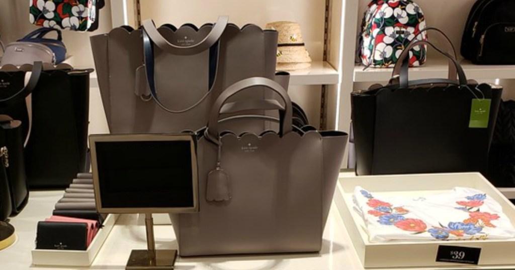 purple Kate Spade purse in the Kate Spade store