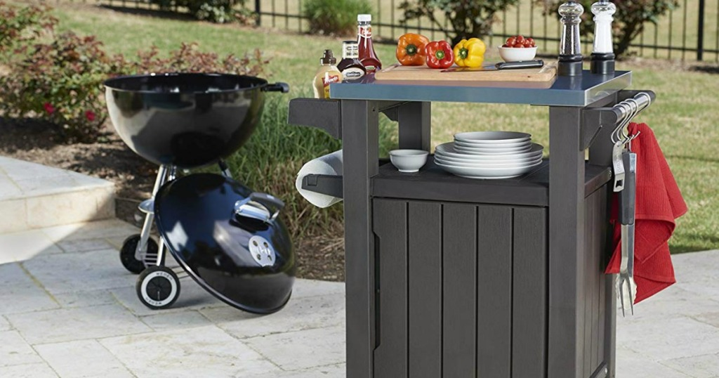 BBQ table with supplies next to grill