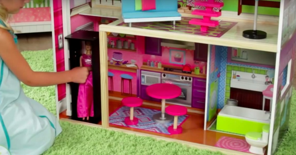 a doll in the elevator of the KidKraft Super Model Dollhouse