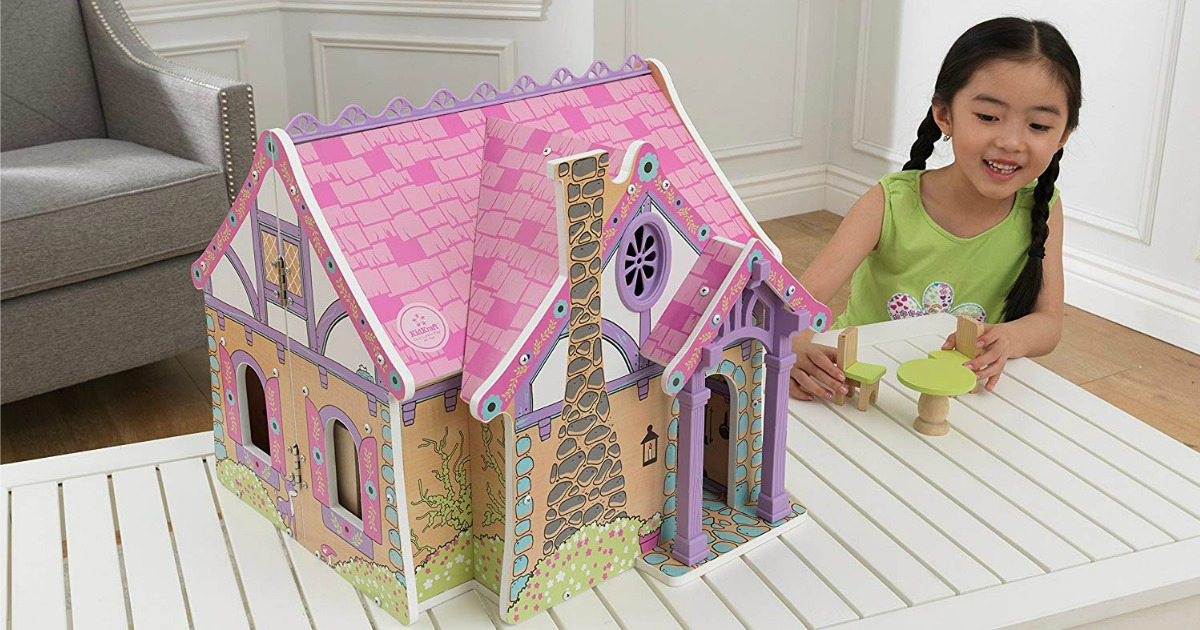 KidKraft Wooden Enchanted Forest Dollhouse on white table