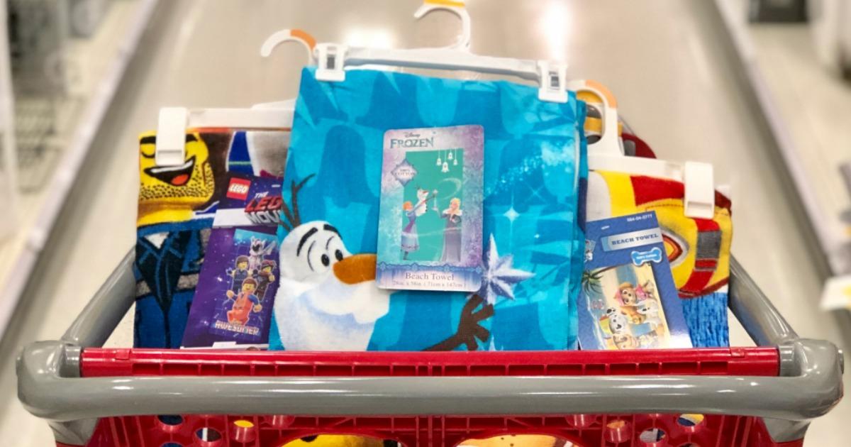 Disney beach towels in a Target cart
