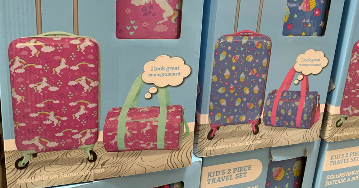 kids unicorn and cupcake luggage on display at store