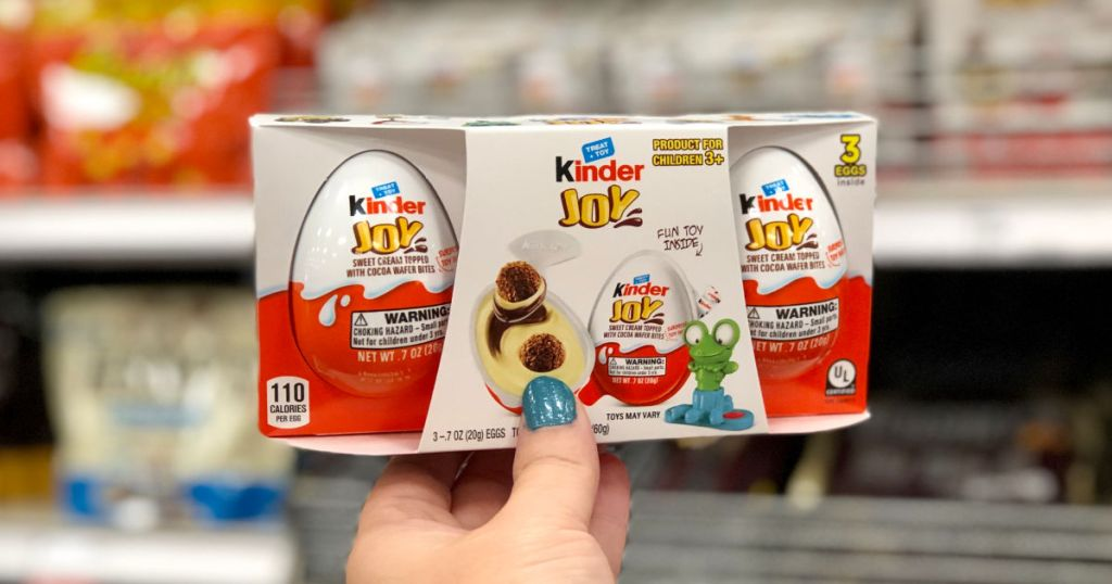 woman hand holding Kinder Joy 3-Pack in target