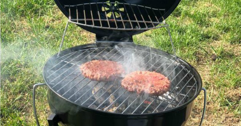black kingsford portable grill grilling 2 burgers