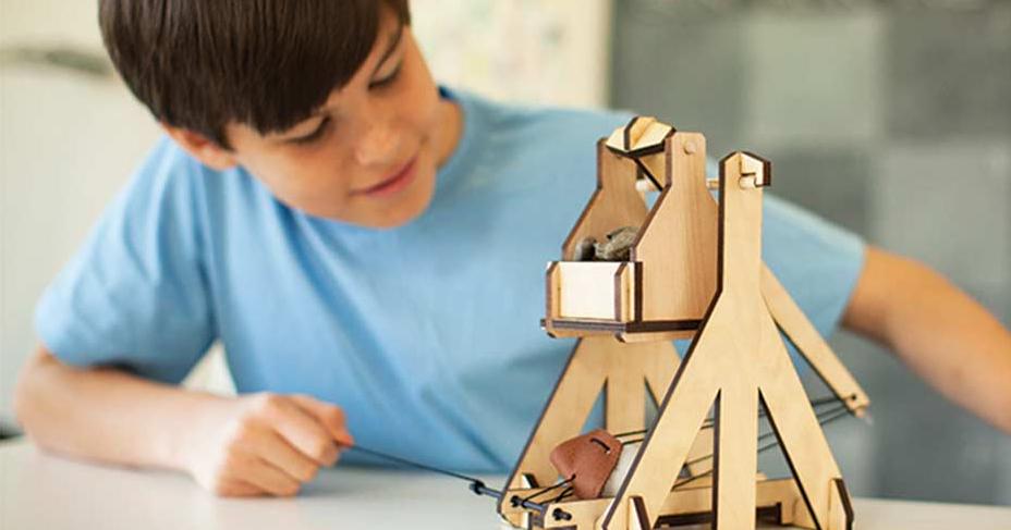 boy working on a Kiwi Co Tinker project