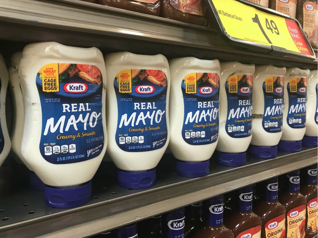 Kraft mayo squeeze bottles lined up on grocery store shelf