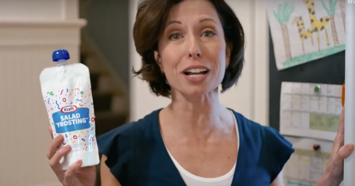 woman holding bottle of Kraft salad frosting
