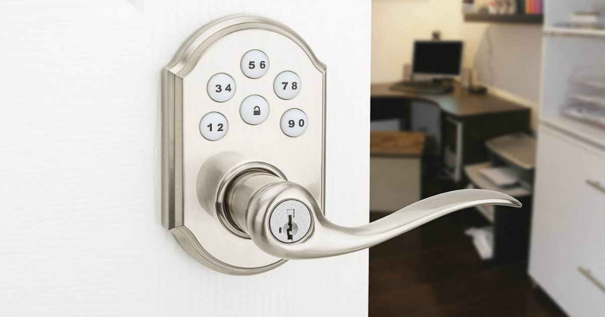 closeup of an electronic keypad lock with handle on a door leading into an office