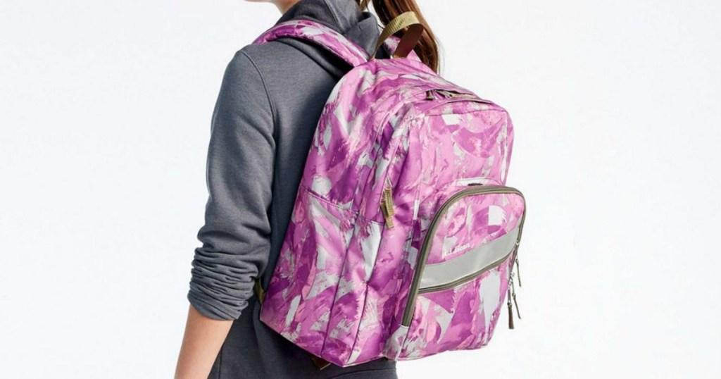 girl wearing pink backpack