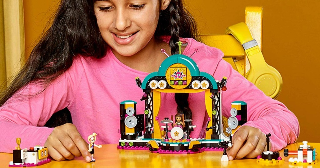 girl playing with LEGO friends set