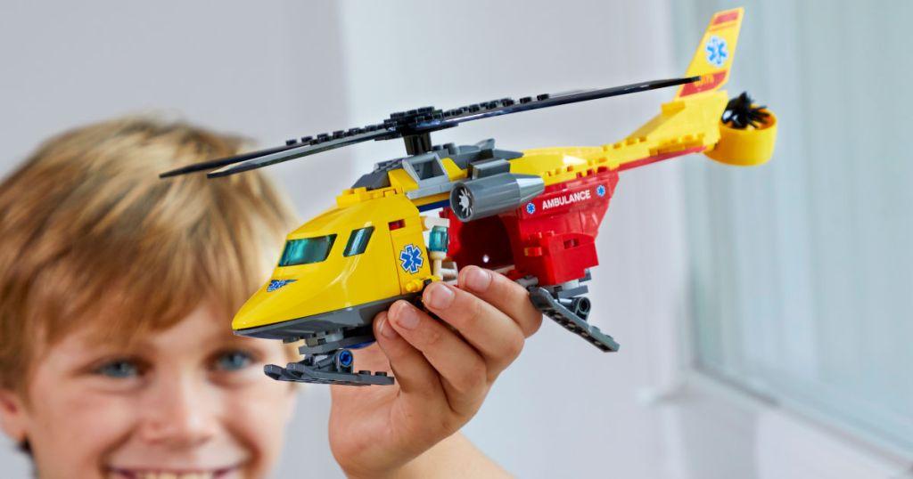 Boy Holding LEGO Helicopter