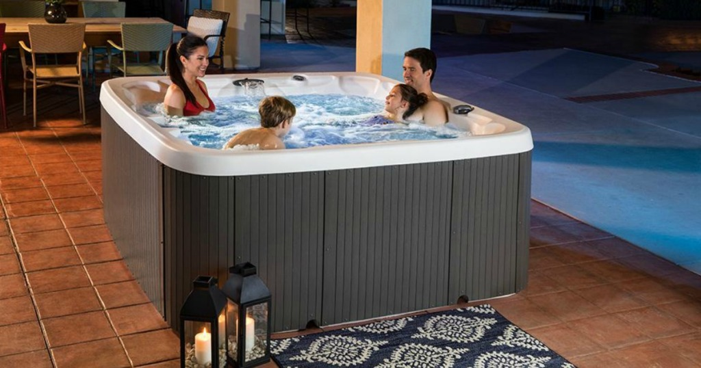 family in Lifesmart 90-Jet 7-Person Standard Spa on patio