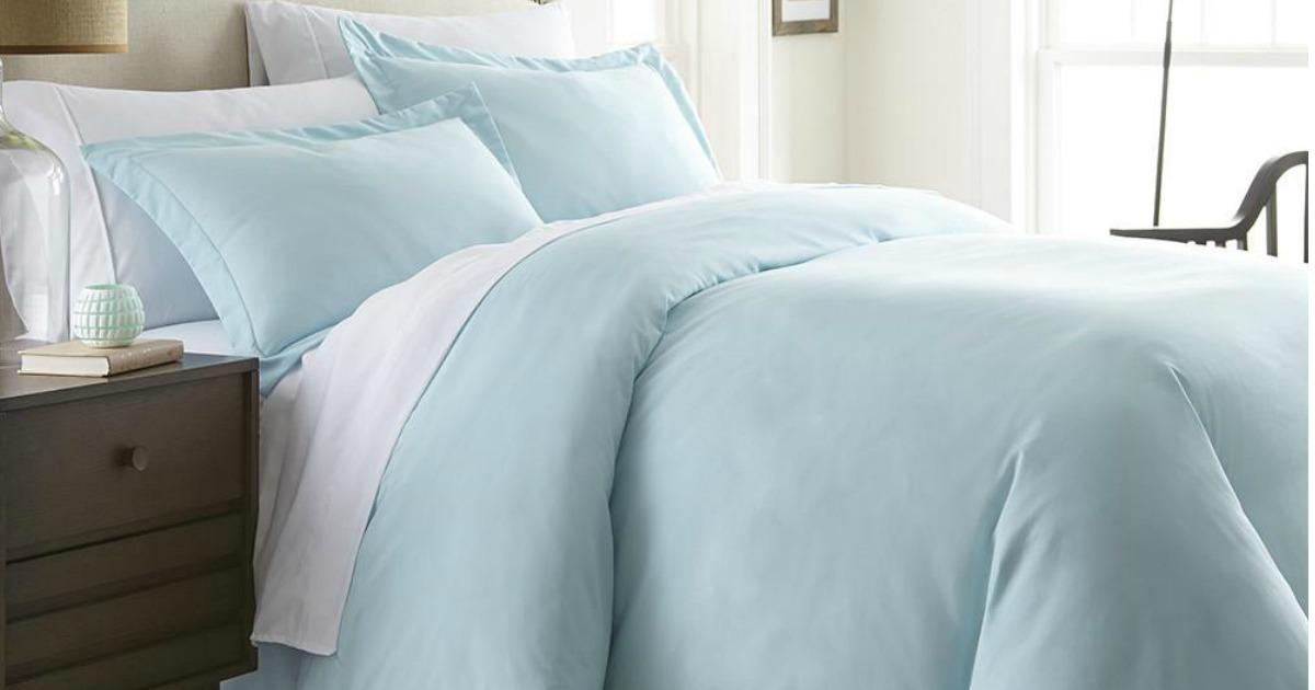 Queen bed featuring light blue Linens & Hutch Duvet Cover Set