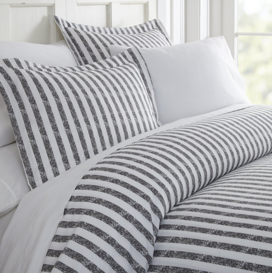 Queen bed featuring gray striped Linens & Hutch Duvet Cover Set