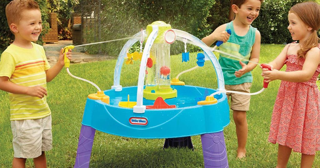 three kids playing in yard with little tikes fun zone battle splash water play table