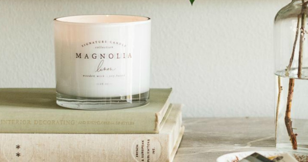 Magnolia Candle on books sitting on a desk