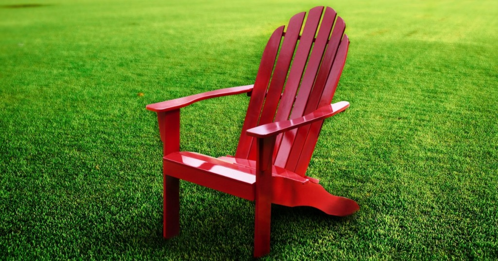 red adirondack chair on lawn