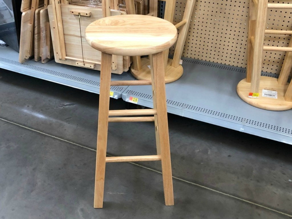 natural wooden stool near store display