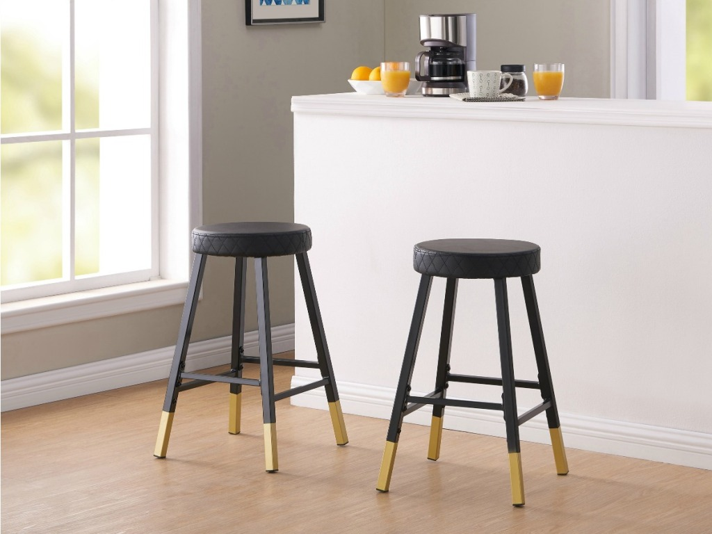 two gold metal dipped stools without backs at kitchen counter