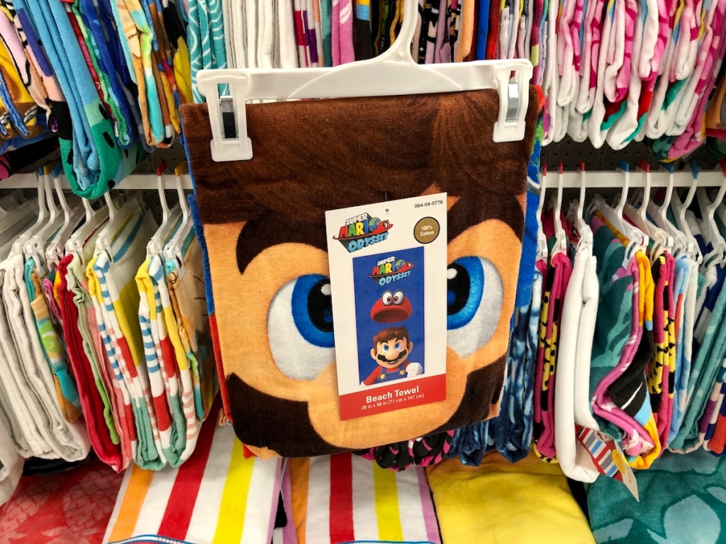 mario beach towel in front of other towels