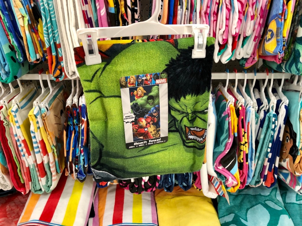 beach towel with hulk on it on a hanger in front of other towels