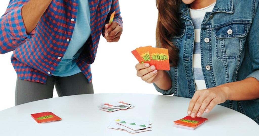Two people playing Mattel Blink Card Game