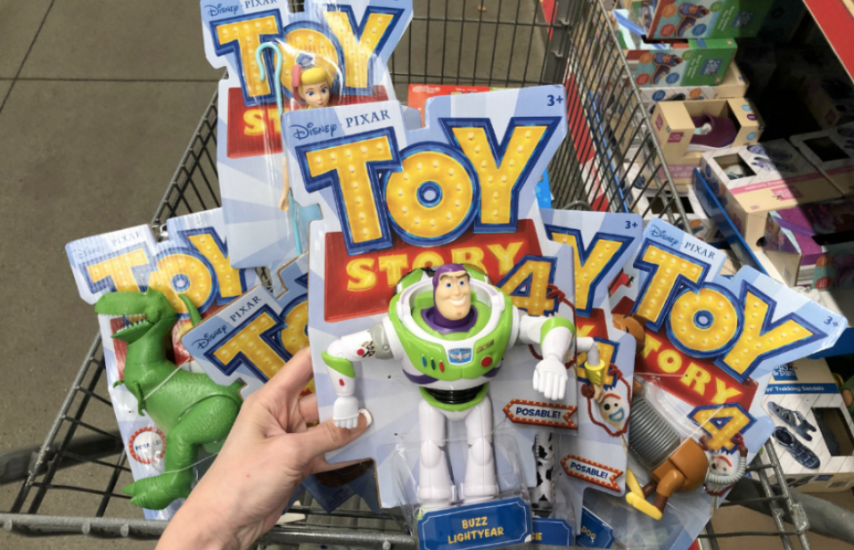 Woman holding Mattel Toy Story 4 Figures in ALDI