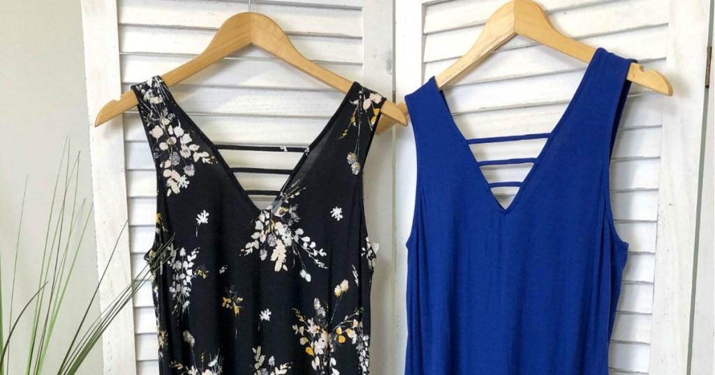 Two summer dresses hanging up on closet door
