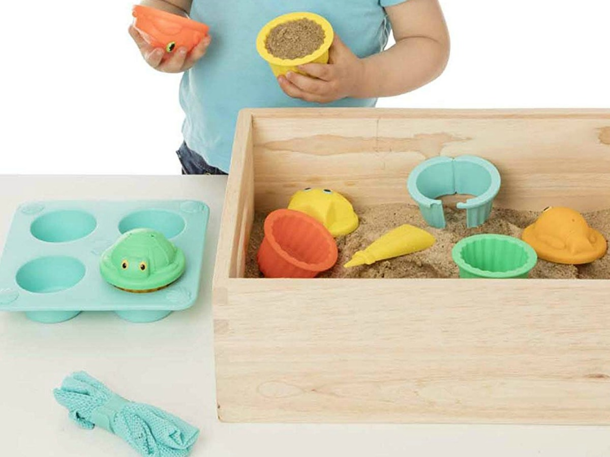 little child playing with Melissa & Doug toys