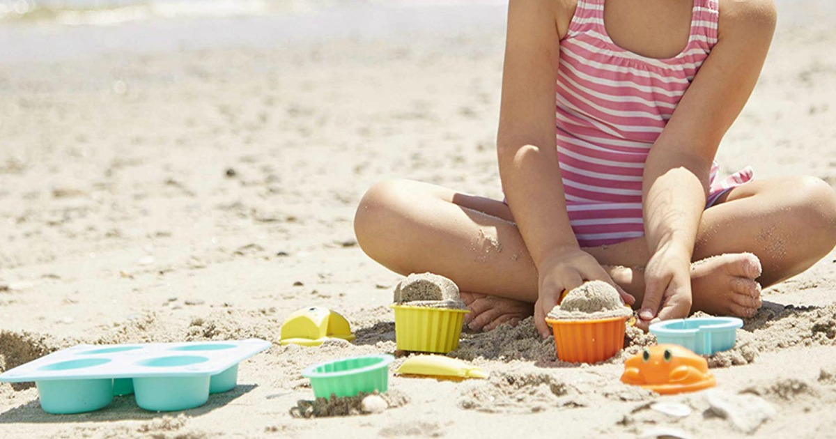 little girl playing with Melissa & Doug toys in the sand