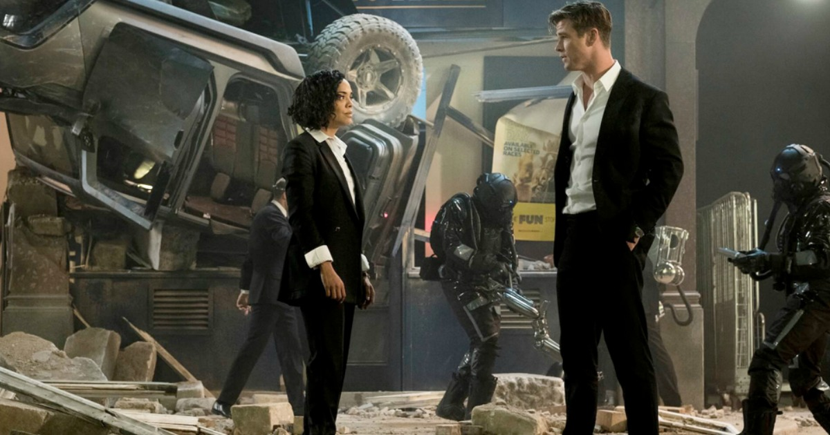 woman and man looking at each other in Men In Black International movie poster