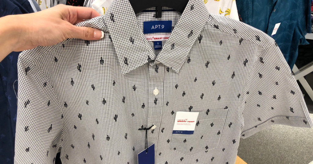 Men's patterned button down shirt being held