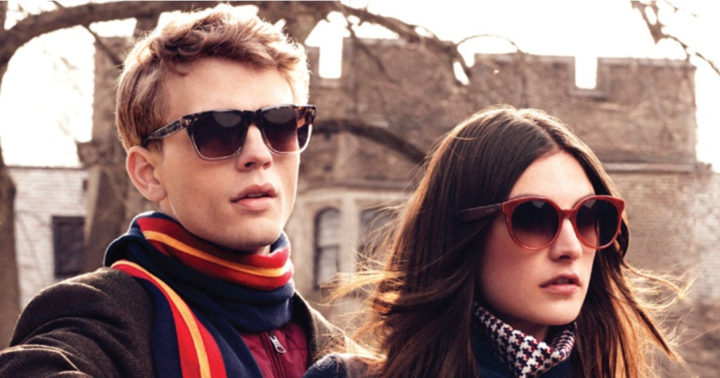 man and woman wearing sunglasses and winter wear