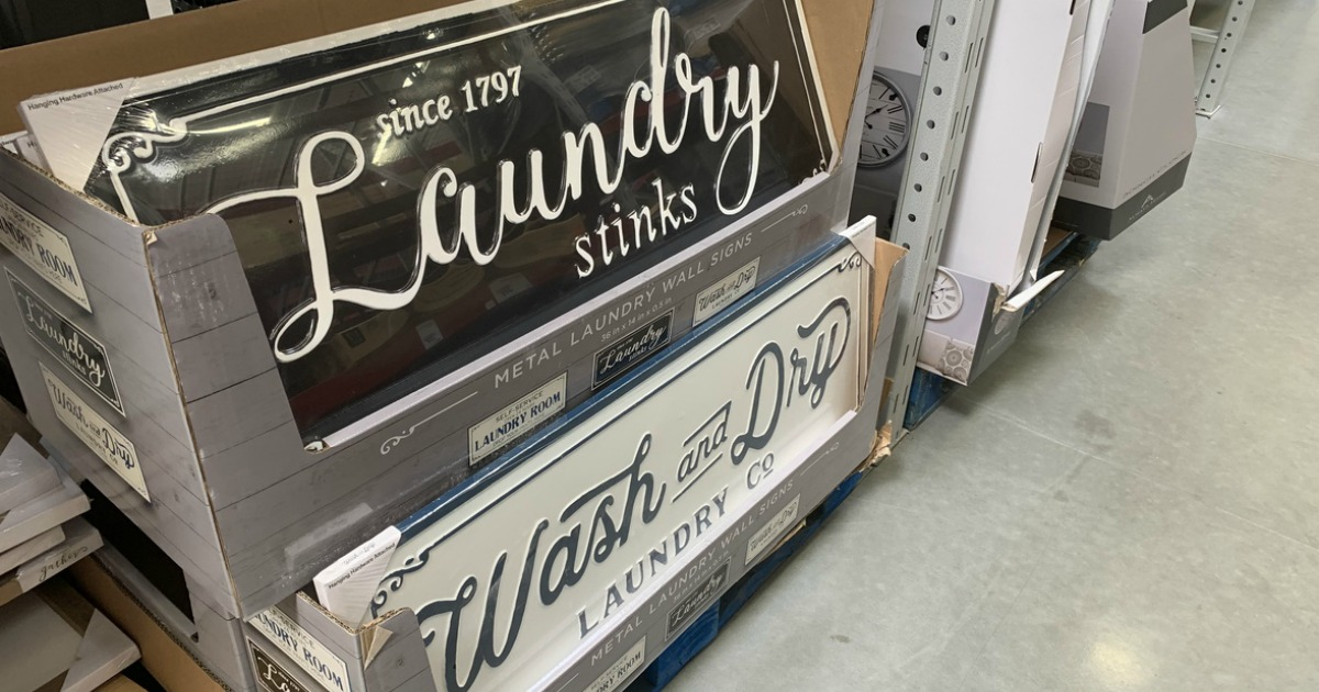 metal laundry signs on display at sam's club