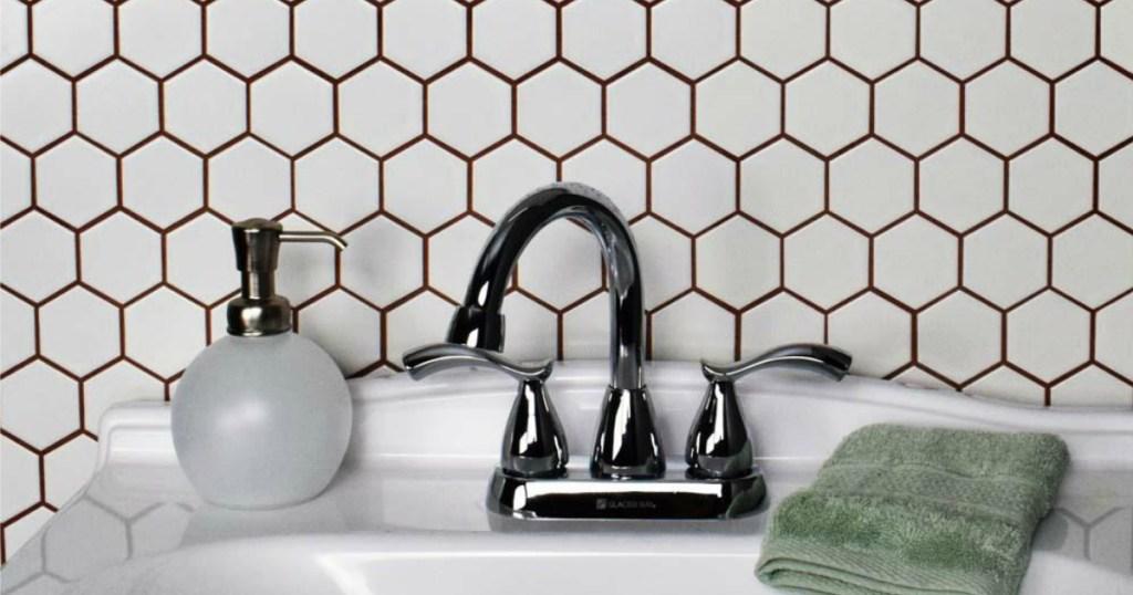 Hex tiles behind bathroom sink