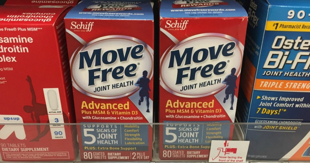 two boxes of Move Free supplements on store shelf next to other joint medicines